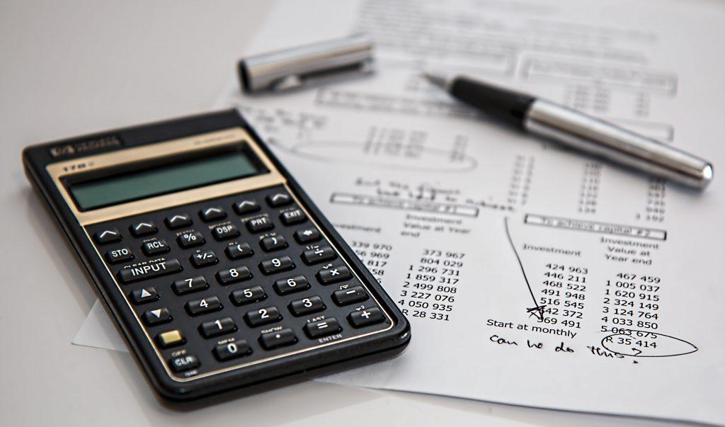 calculator, pen and document