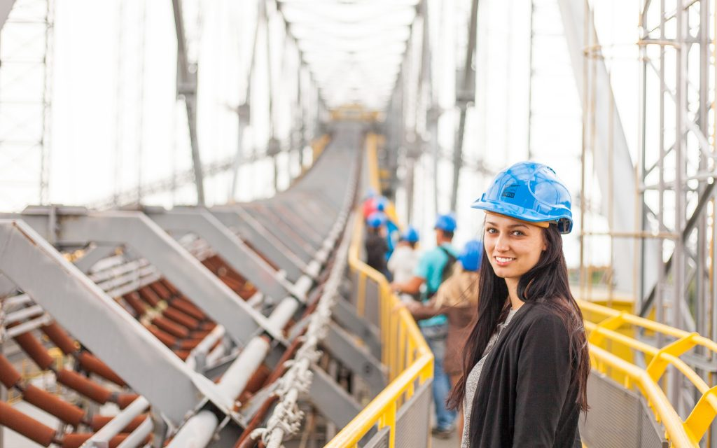 woman wearing hard hat on a construction site